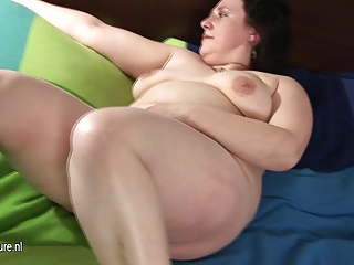 big aged mom playing with her bushy muff