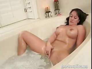 sandy is a naughty brunette milf masturbating in